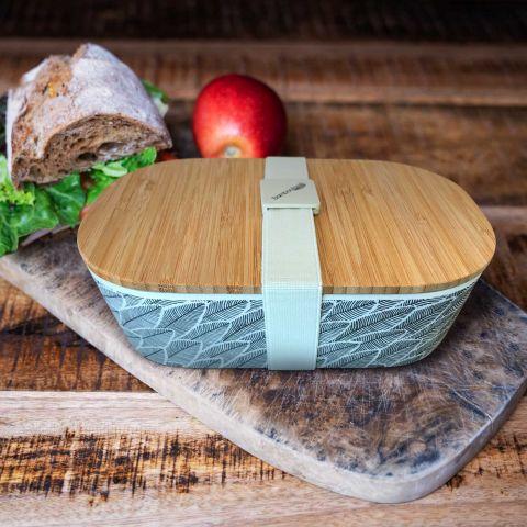 Lunchbox mit Holzdeckel und Palmblätter